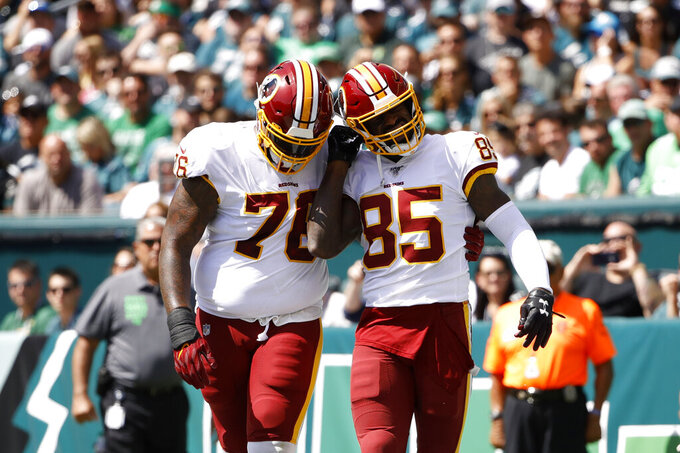 Washington Redskins' Vernon Davis, right, and Morgan Moses celebrate after Davis' touchdown during the first half of an NFL football game against the Philadelphia Eagles, Sunday, Sept. 8, 2019, in Philadelphia. (AP Photo/Matt Rourke)