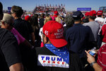 Supporters of President Donald Trump wait for his arrival for a campaign rally Wednesday, Oct. 28, 2020, in Goodyear, Ariz. (AP Photo/Ross D. Franklin)