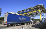 A truck on its way to France waits to be checked by employees of Eurotunnel during a day of test in case of no deal Brexit at the entrance of the Channel tunnel in Folkestone, Tuesday, Sept. 17, 2019. British Prime Minister Boris Johnson has said after a meeting with European Commission President Jean-Claude Juncker that