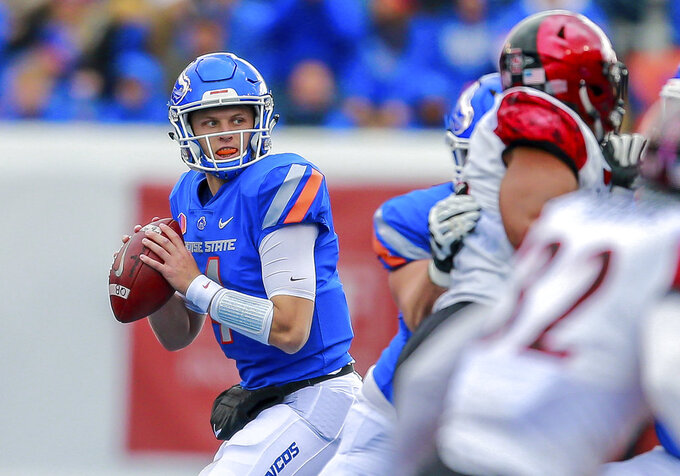 Boise State quarterback Brett Rypien (4) looks downfield in the first half of an NCAA college football game against San Diego State, Saturday, Oct. 6, 2018, in Boise, Idaho.(AP Photo/Steve Conner)
