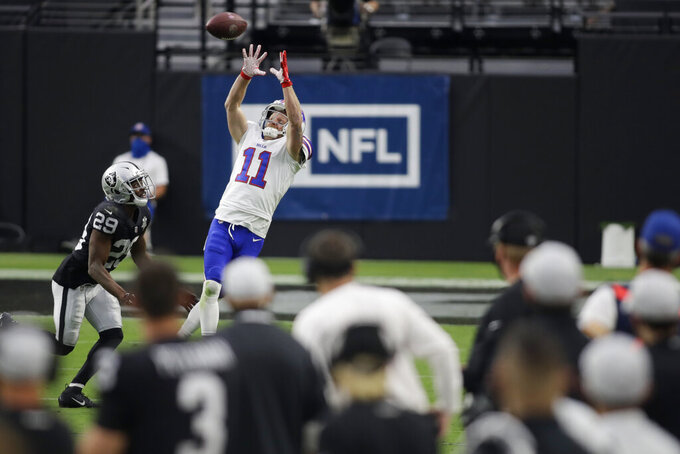 Buffalo Bills wide receiver Cole Beasley (11) reaches up for a pass over Las Vegas Raiders free safety Lamarcus Joyner (29) during the second half of an NFL football game, Sunday, Oct. 4, 2020, in Las Vegas. (AP Photo/Isaac Brekken)