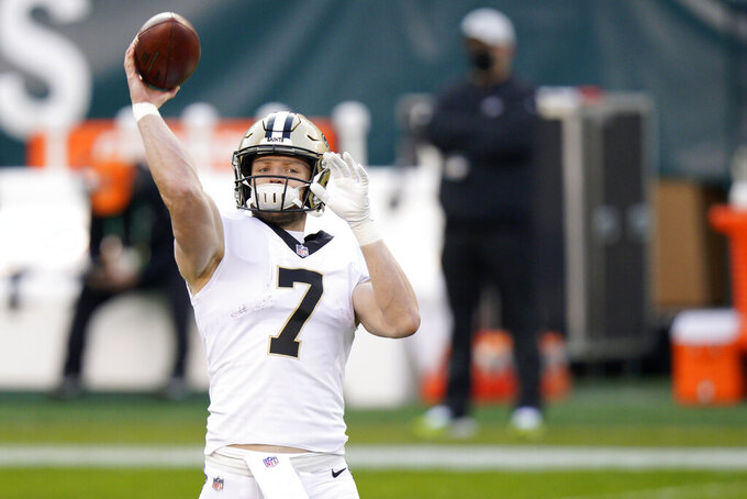 New Orleans Saints' Taysom Hill warms up before an NFL football game against the Philadelphia Eagles, Sunday, Dec. 13, 2020, in Philadelphia. (AP Photo/Chris Szagola)