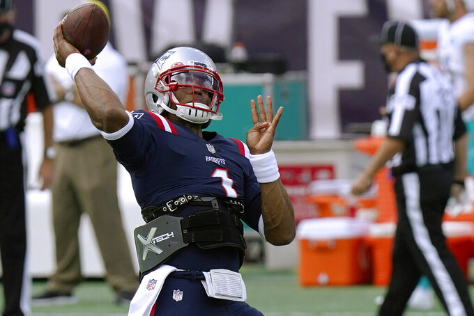 New England Patriots quarterback Cam Newton warms up before an NFL football game against the Miami Dolphins, Sunday, Sept. 13, 2020, in Foxborough, Mass. (AP Photo/Steven Senne)