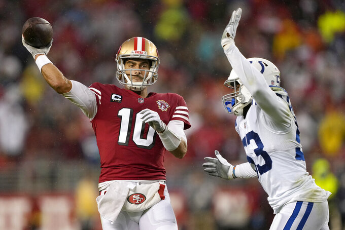 San Francisco 49ers quarterback Jimmy Garoppolo (10) passes against Indianapolis Colts outside linebacker Darius Leonard during the first half of an NFL football game in Santa Clara, Calif., Sunday, Oct. 24, 2021. (AP Photo/Tony Avelar)