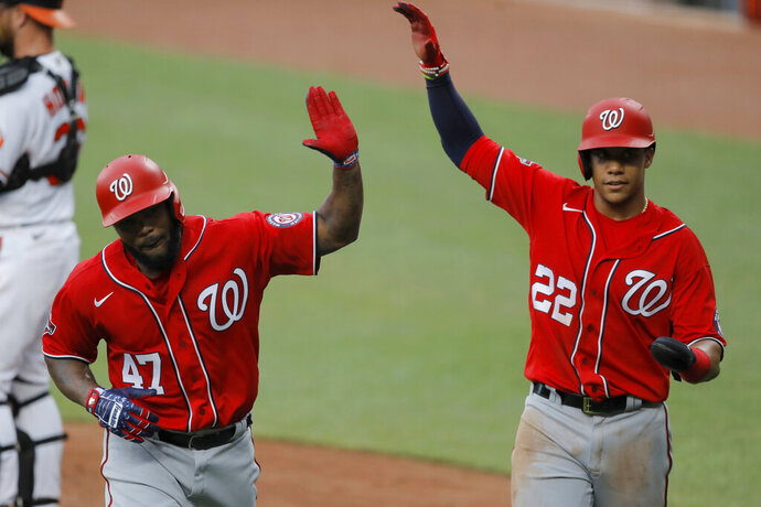 Washington Nationals' Howie Kendrick (47) is greeted with