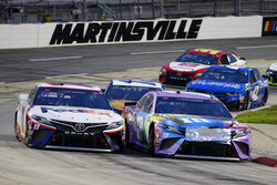 FILE - In this June 10, 2020, file photo, Denny Hamlin (11) and Kyle Busch (18) come through a turn during a NASCAR Cup Series auto race at  in Martinsville, Va. Hamlin's dazzling season could potentially collapse if things go sideways Sunday, Oct. 31, 2020, at Martinsville Speedway, NASCAR's oldest and shortest track that has been slotted as the final playoff elimination race. (AP Photo/Steve Helber, File)