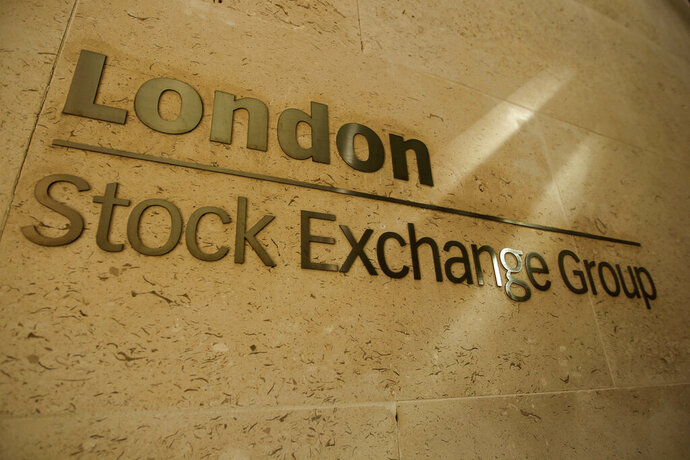 FILE - This Thursday, Sept. 22, 2011 file photo shows a sign outside the Stock Exchange in the City of London. The Hong Kong stock exchange said Wednesday Sept. 11, 2019, it has started talks to buy the London Stock Exchange that would value the British company at 29.6 billion pounds ($36.6 billion). The Hong Kong Exchanges and Clearing Ltd. said a deal would provide the London Stock Exchange with a key opening to Asian markets and underpin the British capital's role as a financial hub. (AP Photo/Matt Dunham, File)