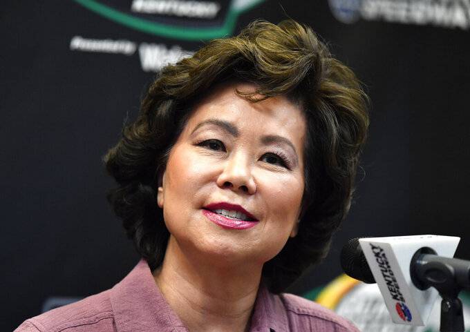 Transportation Secretary Elaine Chao addresses the media before the NASCAR series auto race at Kentucky Speedway in Sparta, Ky., Saturday, July 13, 2019.. Chao will be the honorary race director for this evening's NASCAR race. (AP Photo/Timothy D. Easley)