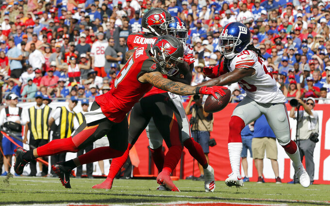 Tampa Bay Buccaneers wide receiver Mike Evans (13) beats New York Giants cornerback Janoris Jenkins (20) on a 3-yard touchdown reception during the first half of an NFL football game Sunday, Sept. 22, 2019, in Tampa, Fla. (AP Photo/Mark LoMoglio)