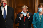 Sen. Richard Shelby, R-Ala., left, Sen. Lindsey Graham, R-S.C., center, and Sen. Susan Collins, R-Maine, right, listen during a news conference on on Capitol Hill in Washington, Monday, July 27, 2020, to highlight the new Republican coronavirus aid package. (AP Photo/Susan Walsh)