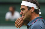 Switzerland's Roger Federer wipes his face during his ATP Tour Singles, Men, Round of 16 tennis match against Canada's Felix Auger-Aliassime in Halle, Germany, Wednesday, June 16, 2021. (Friso Gentsch/dpa via AP)
