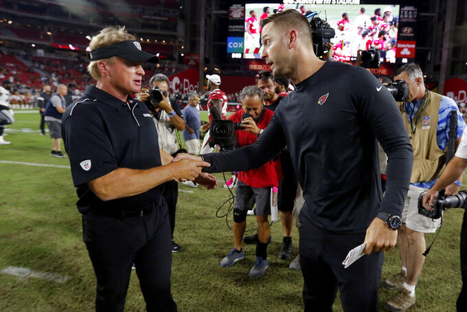 Arizona Cardinals head coach Kliff Kingsbury, right, greets Oakland Raiders head coach Jon Gruden after an an NFL preseason football game, Thursday, Aug. 15, 2019, in Glendale, Ariz. The Raiders won 33-26. (AP Photo/Ralph Freso)