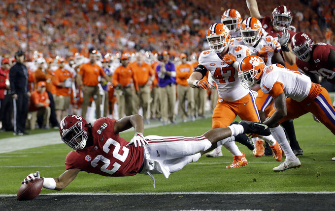 Alabama's Najee Harris reaches for the end zone during the first half the NCAA college football playoff championship game against Clemson, Monday, Jan. 7, 2019, in Santa Clara, Calif. (AP Photo/David J. Phillip)