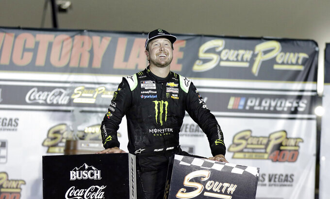 FILE - In this Sunday, Sept. 27, 2020, file photo, Kurt Busch celebrates after winning a NASCAR Cup Series auto race in Las Vegas.Busch has welcomed the uncertainty of this season as he chases a playoff berth while pondering his future in NASCAR. Busch posted the fastest practice time Saturday, July 3, 2021, as NASCAR's Cup Series returned to Road America for the first time since 1956. (AP Photo/Isaac Brekken, File)