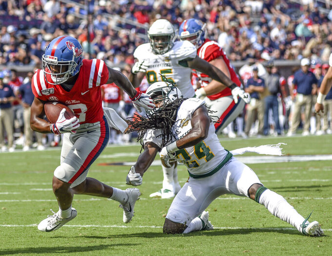 Mississippi wide receiver Elijah Moore (8) gets away from Southeastern Louisiana defensive back Shawntrez Spates (24) to score during an NCAA college football game, Saturday, Sept. 14, 2019 in Oxford, Miss. (Bruce Newman/The Oxford Eagle via AP)