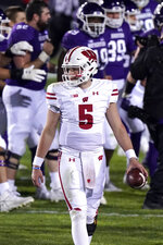 Wisconsin quarterback Graham Mertz (5) walks off the field after a 17-7 loss to Northwestern in an NCAA college football game in Evanston, Ill., Saturday, Nov. 21, 2020. (AP Photo/Nam Y. Huh)