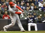 Cincinnati Reds' Jose Peraza hits a two-run scoring double during the sixth inning of a baseball game against the Milwaukee Brewers Monday, April 16, 2018, in Milwaukee. (AP Photo/Morry Gash)