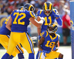 Los Angeles Rams wide receiver JoJo Natson (19) is congratulated by center Aaron Neary (72), offensive guard Jamil Demby (64), and wide receiver KhaDarel Hodge (11) after scoring a touchdown against the Dallas Cowboys during the first half of a preseason NFL football game Saturday, Aug. 17, 2019, in Honolulu. (AP Photo/Marco Garcia)
