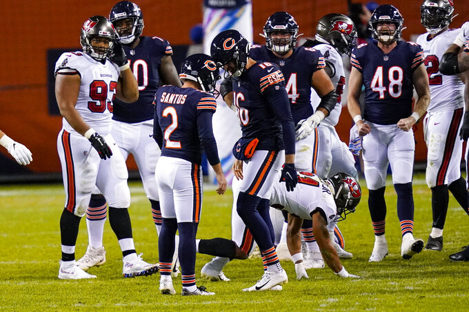 Chicago Bears' Cairo Santos (2) celebrates a go-ahead field goal with holder Pat O'Donnell (16) during the second half of the team's NFL football game against the Tampa Bay Buccaneers in Chicago, Thursday, Oct. 8, 2020. The Bears won 20-19. (AP Photo/Charles Rex Arbogast)