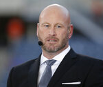 "FILE - In this Sept. 19, 2016, file photo, Trent Dilfer talks during ESPN's ""Monday Night Countdown"" before an NFL football game between the Chicago Bears and the Philadelphia Eagles, in Chicago. Dilfer has been head coach for the national high school quarterback competition known as Elite 11 since 2011, and even in that short period of time the quality of players coming through the program has drastically improved. (AP Photo/Charles Rex Arbogast, File)"