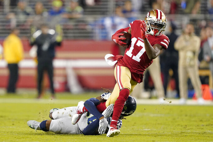 San Francisco 49ers wide receiver Emmanuel Sanders (17) is tackled by Seattle Seahawks cornerback Shaquill Griffin during the first half of an NFL football game in Santa Clara, Calif., Monday, Nov. 11, 2019. (AP Photo/Tony Avelar)