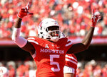 Houston wide receiver Marquez Stevenson celebrates his touchdown during the first half of an NCAA college football game against South Florida, Saturday, Oct. 27, 2018, in Houston. (AP Photo/Eric Christian Smith)
