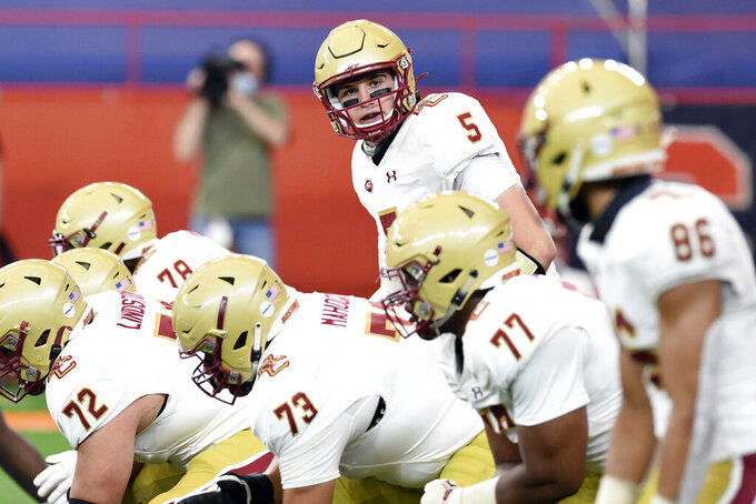 Boston College quarterback Phil Jurkovec (5) looks down the line of scrimmage during the first half of NCAA college football game against Syracuse, Saturday, Nov. 7, 2020, at the Carrier Dome in Syracuse, N.Y. (Dennis Nett/The Post-Standard via AP)