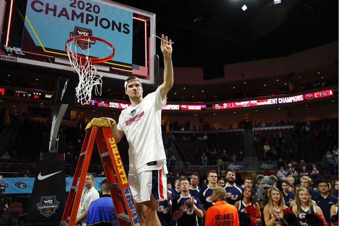 Gonzaga's Corey Kispert (24) holds up a pice of the net after defeating Saint Mary's in an NCAA college basketball game in the final of the West Coast Conference men's tournament Tuesday, March 10, 2020, in Las Vegas. (AP Photo/John Locher)