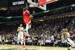 Toronto Raptors forward Pascal Siakam (43) dunks against the Milwaukee Bucks late in the second half of Game 5 of the NBA basketball playoffs Eastern Conference finals in Milwaukee on Thursday, May 23, 2019. Toronto won 105-99. (Frank Gunn/The Canadian Press via AP)