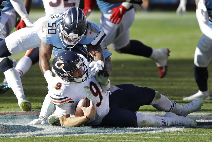 Tennessee Titans linebacker Derick Roberson (50) brings down Chicago Bears quarterback Nick Foles (9) in the second half of an NFL football game Sunday, Nov. 8, 2020, in Nashville, Tenn. (AP Photo/Ben Margot)