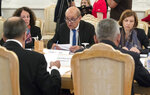 France Foreign Minister Jean-Yves Le Drian, center, and Defence Minister Florence Parly, right, talk with Russian Foreign Minister Sergey Lavrov, back to the camera left, and Defence Minister Sergei Shoigu, back to the camera right, during their meeting in Moscow, Russia, Monday, Sept. 9, 2019. (AP Photo/Pavel Golovkin)