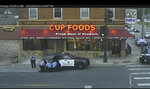In this image from Minneapolis city surveillance video, Minneapolis police are seen attempting to take George Floyd into custody May 25, 2020, in Minneapolis, Minn. The video was shown as Hennepin County Judge PeterCahill presides Monday, March 29, 2021, in the trial of former Minneapolis police officer Derek Chauvin, in the death of George Floyd at the Hennepin County Courthouse in Minneapolis, Minn. (Court TV via AP, Pool)