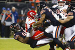 Kansas City Chiefs running back Spencer Ware (39) is pulled back by Chicago Bears outside linebacker Leonard Floyd (94) in the first half of an NFL football game in Chicago, Sunday, Dec. 22, 2019. (AP Photo/Charles Rex Arbogast)