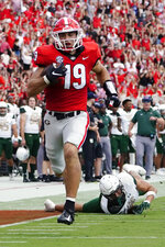 Georgia tight end Brock Bowers (19) runs away from UAB safety Kristopher Moll (6) for a touchdown after a catch during the first half of an NCAA college football game Saturday, Sept. 11, 2021, in Athens, Ga. (AP Photo/John Bazemore)