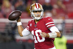 San Francisco 49ers quarterback Jimmy Garoppolo throws a pass against the Los Angeles Rams during the second half of an NFL football game in Santa Clara, Calif., Saturday, Dec. 21, 2019. (AP Photo/Tony Avelar)