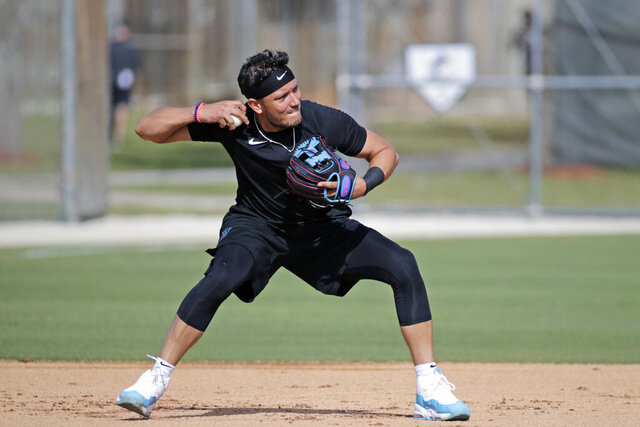 Miami Marlins shortstop Miguel Rojas runs a drill at spring training baseball camp in Jupiter, Fla., Wednesday, Feb. 12, 2020. (David Santiago/Miami Herald via AP)
