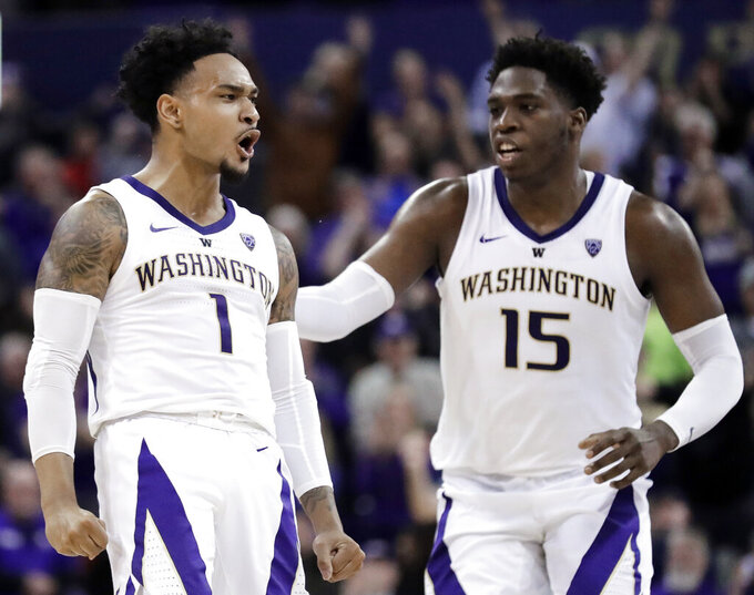 Washington guard David Crisp (1) celebrates with forward Noah Dickerson (15) during overtime in an NCAA college basketball game against Oregon State, Wednesday, March 6, 2019, in Seattle. Washington won 81-76. (AP Photo/Ted S. Warren)