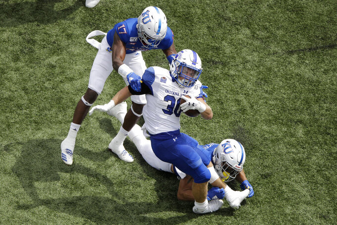 Indiana State running back Titus McCoy (30) is tackled by Kansas cornerback Elijah Jones (17) and safety Bryce Torneden (1) during the second half of an NCAA college football game Saturday, Aug. 31, 2019, in Lawrence, Kan. Kansas won 24-17. McCoy was injured on the play. (AP Photo/Charlie Riedel)