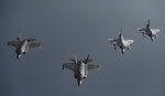 In this Tuesday, May 21, 2019 photo, Qatari Air Force Mirage 2000s, right, and U.S. F-35A Lightning IIs fly in formation over Southwest Asia in undisclosed location. (Senior Airman Keifer Bowes/U.S. Air Force via AP)