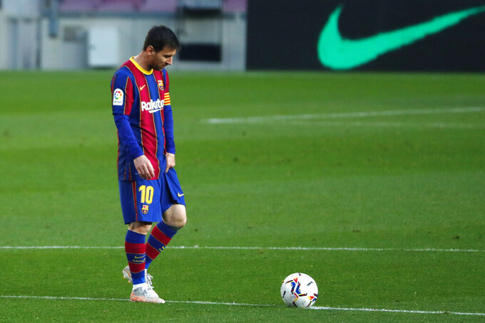 FILE - In this file photo dated Thursday, April 29, 2021, Barcelona's Lionel Messi reacts during the Spanish La Liga match against Granada at the Camp Nou stadium in Barcelona, Spain. Lionel Messi and Barcelona are closer to signing a new deal that would keep the Argentina soccer star at the Spanish club through the end of his playing career, according to an unidentified insider Friday July 16, 2021. (AP Photo/Joan Monfort, FILE)