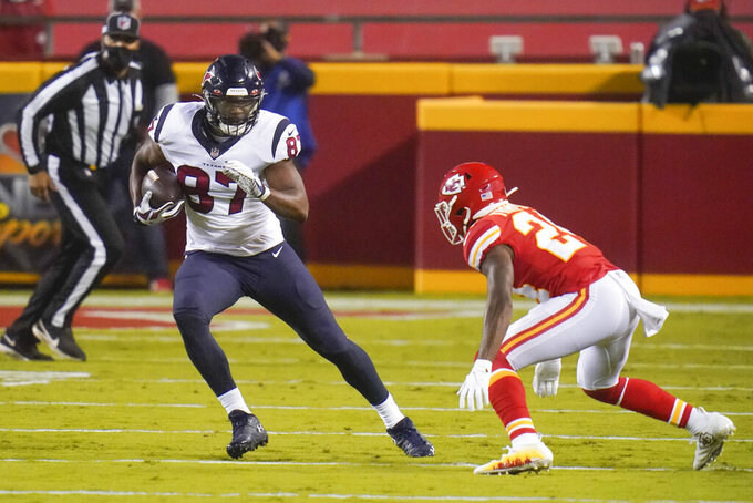 Houston Texans tight end Darren Fells (87) carries the ball against Kansas City Chiefs safety Tedric Thompson (24) in the first half of an NFL football game Thursday, Sept. 10, 2020, in Kansas City, Mo. (AP Photo/Jeff Roberson)