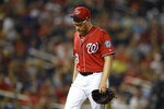 Washington Nationals' Sean Doolittle walks to the dugout after he was pulled from the baseball game during the ninth inning against the Milwaukee Brewers, Saturday, Aug. 17, 2019, in Washington. The Brewers won 15-14 in 14 innings. (AP Photo/Nick Wass)