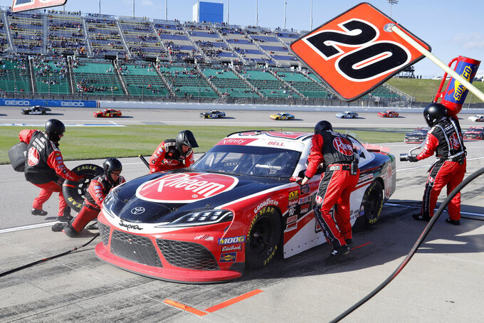 Christopher Bell (20) pits during a NASCAR Xfinity Series auto race at Kansas Speedway in Kansas City, Kan., Saturday, Oct. 19, 2019. (AP Photo/Colin E. Braley)