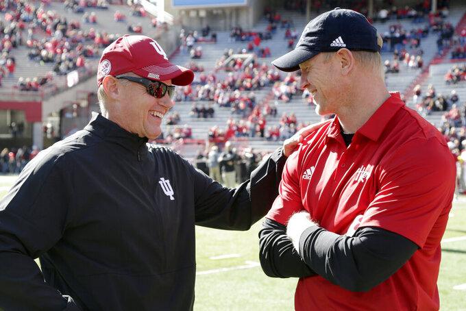 Indiana head coach Tom Allen, left, and Nebraska head coach Scott Frost chat before an NCAA college football game in Lincoln, Neb., Saturday, Oct. 26, 2019. (AP Photo/Nati Harnik)