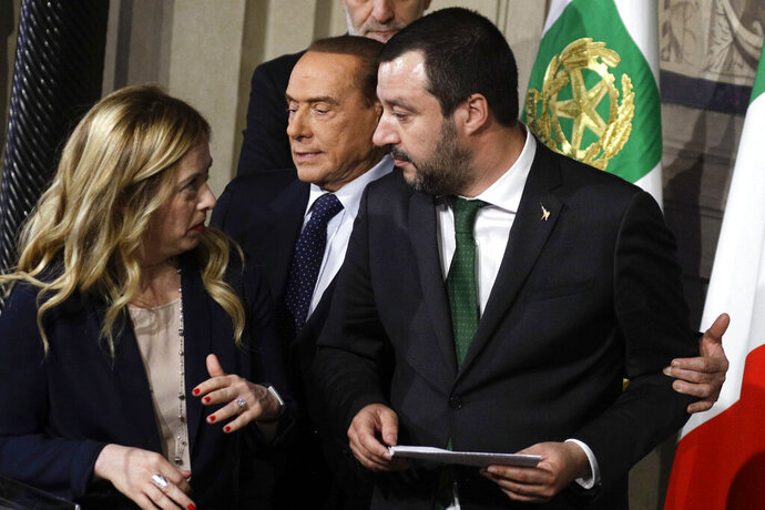 "FILE - In this Thursday, April 12, 2018 file photo, Forza Italia Leader Silvio Berlusconi, center, Brothers of Italy party Leader Giorgia Meloni, left, and Northern League Leader Matteo Salvini meet journalists at the Quirinale presidential palace after talks with Italian President Sergio Mattarella, in Rome. Italy's politically battered Matteo Salvini and ally Giorgia Meloni are preparing for a weekend march on Rome to rally the right-wing after Salvini's political miscalculation got him ousted from his powerful post as interior minister. Meloni's post-fascist Brothers Of Italy party is growing in popularity as Italy's political landscape shifts even more toward the right. Salvini calls the rally ""a peaceful day of Italian pride"" but many believe it will attract far-right extremists. (AP Photo/Gregorio Borgia, File)"