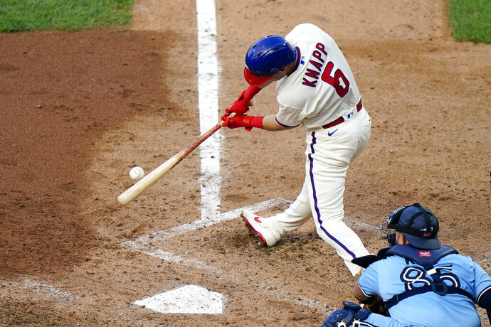 Philadelphia Phillies' Andrew Knapp hits a two-run triple off Toronto Blue Jays pitcher Thomas Hatch during the first inning of the fifth baseball game in a doubleheader, Friday, Sept. 18, 2020, in Philadelphia. (AP Photo/Matt Slocum)