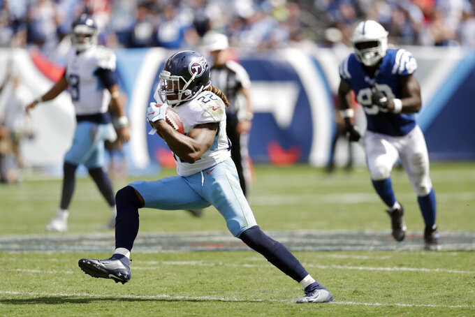 Tennessee Titans running back Derrick Henry (22) carries the ball against the Indianapolis Colts in the second half of an NFL football game Sunday, Sept. 15, 2019, in Nashville, Tenn. (AP Photo/James Kenney)