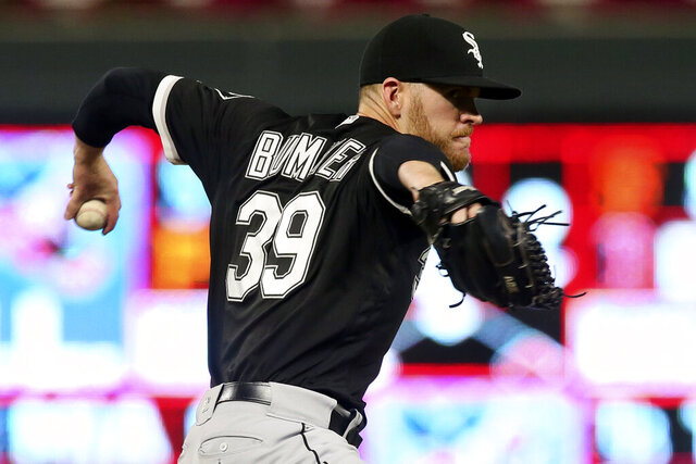 FILE - In this Sept. 17, 2019, file photo, Chicago White Sox pitcher Aaron Bummer throws against the Minnesota Twins during a baseball game in Minneapolis. Bummer used that heavy sinker to become one of the AL's most reliable relievers last year, compiling a 2.13 ERA and his first career save in 58 appearances. (AP Photo/Jim Mone, File)