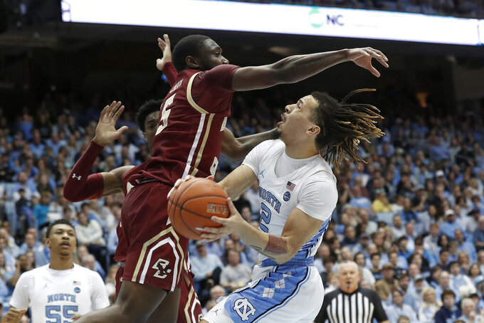 Boston College guard Jay Heath, left, blocks North Carolina guard Cole Anthony, right, during the first half of an NCAA college basketball game in Chapel Hill, N.C., Saturday, Feb. 1, 2020. (AP Photo/Gerry Broome)