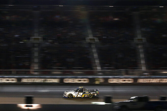 Sheldon Creed (2) races through Turn 4 during the NASCAR Truck Series auto race at Phoenix Raceway, Friday, Nov. 6, 2020, in Avondale, Ariz. Creed won the race and the season championship. (AP Photo/Ralph Freso)